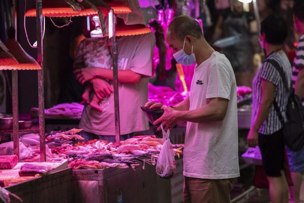 Chinese shop at an open-air market in Guangzhou on May 24. Pork is central to Chinese cuisine and culture. Photo: Bloomberg