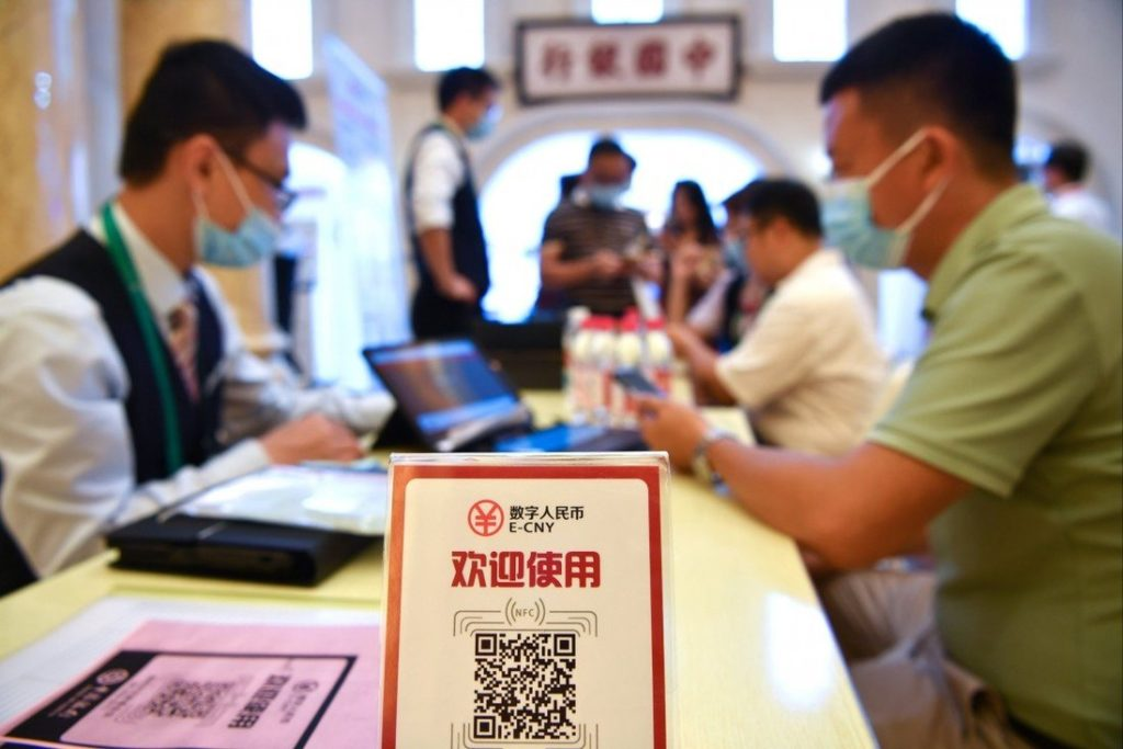 A man signs up to pay with the e-yuan, China's digital currency, at an expo in Hainan on May 8